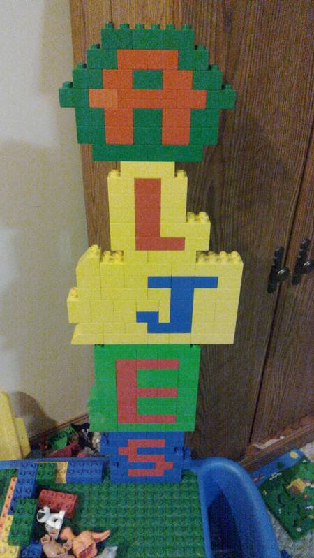 Our family in Lego block letters